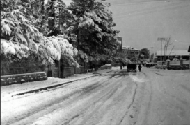 Snowy day on Bethlehem Road in Upper Baq'a not far from the railroad crossing. The Krikorian home was in the foreground on the left. You can see the German Hospice of St. Charles straight ahead, Jerusalem, early 1940's